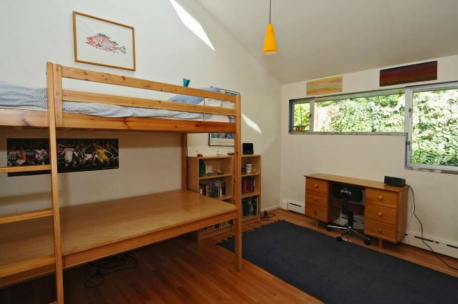 Bedroom of 3512 N.W. 70th St. The 3,440-square-foot house, built in 1953, has four bedrooms, 2.5 bathrooms, high ceilings, skylights, French doors, a family room, a bar and a patio on a 6,420-square-foot lot. It's listed for $839,000. Photo: Courtesy Lee Whalen/Windermere Real Estate
