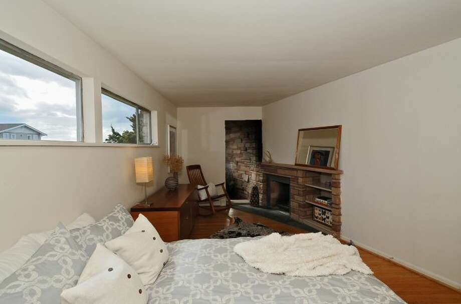 Master bedroom of 3512 N.W. 70th St. The 3,440-square-foot house, built in 1953, has four bedrooms, 2.5 bathrooms, high ceilings, skylights, French doors, a family room, a bar and a patio on a 6,420-square-foot lot. It's listed for $839,000. Photo: Courtesy Lee Whalen/Windermere Real Estate