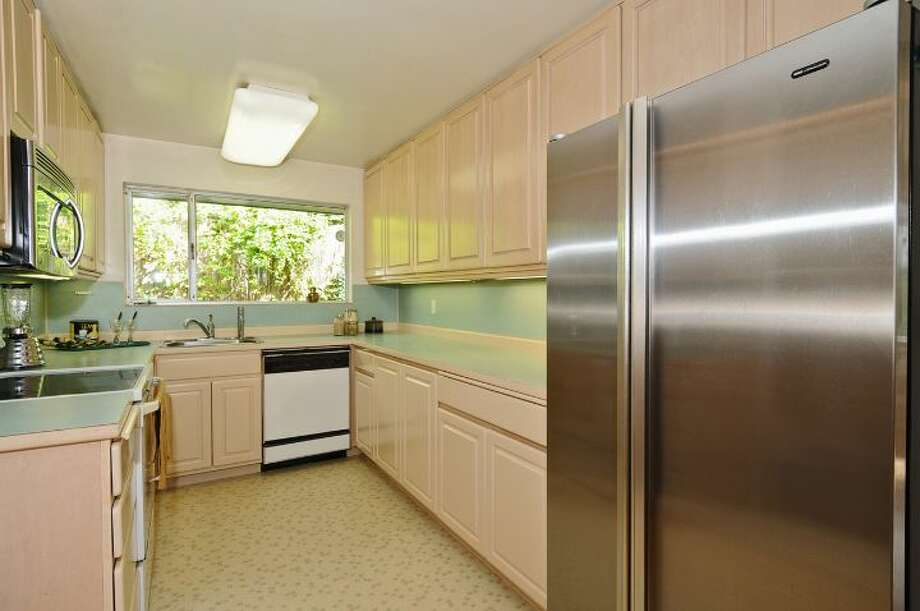 Kitchen of 3512 N.W. 70th St. The 3,440-square-foot house, built in 1953, has four bedrooms, 2.5 bathrooms, high ceilings, skylights, French doors, a family room, a bar and a patio on a 6,420-square-foot lot. It's listed for $839,000. Photo: Courtesy Lee Whalen/Windermere Real Estate
