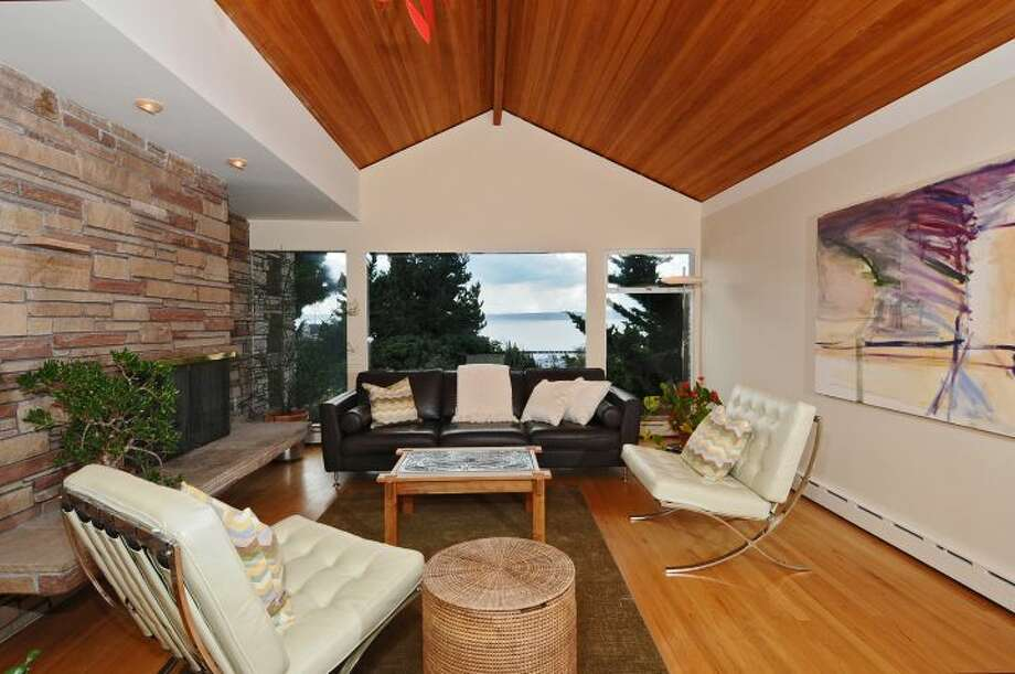 Living room of 3512 N.W. 70th St. The 3,440-square-foot house, built in 1953, has four bedrooms, 2.5 bathrooms, high ceilings, skylights, French doors, a family room, a bar and a patio on a 6,420-square-foot lot. It's listed for $839,000. Photo: Courtesy Lee Whalen/Windermere Real Estate