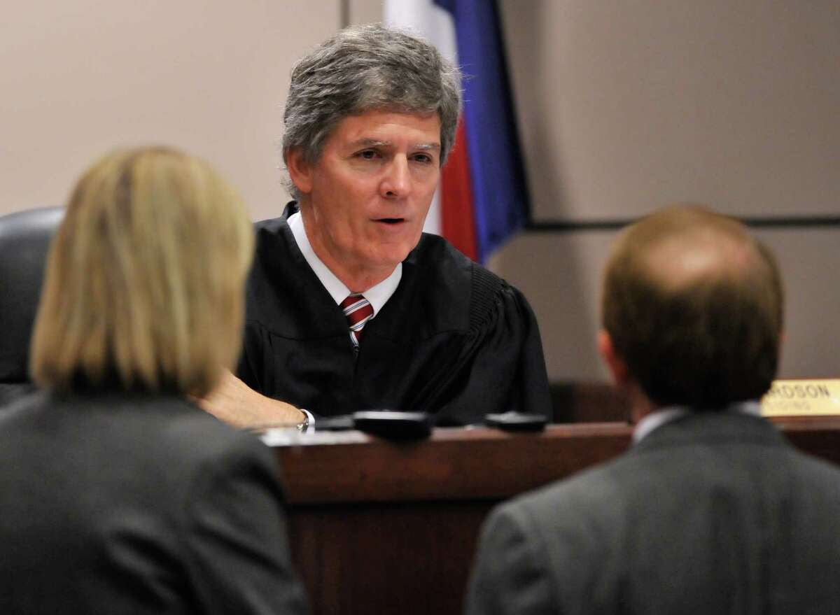 Visiting Judge Bert Richardson talks to prosecuting attornies Crystal Chandler and Kevin Yeary during a new trial hearing for death row inmate Noah Espada Friday at the Cardena-Reeves Justice Center.