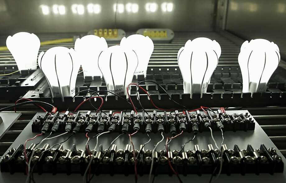 General Electric's 9-watt Energy Smart LED lightbulbs are tested in an oven in East Cleveland, Ohio. Photo: Mark Duncan, AP