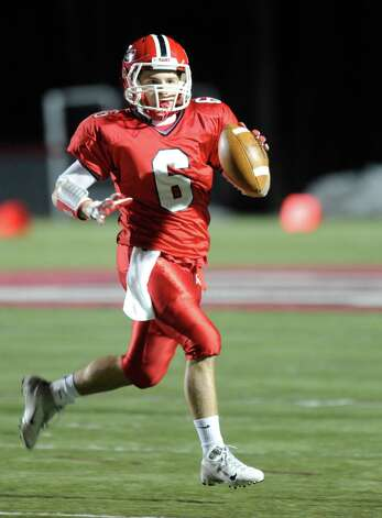 New Canaan's Teddy Bossidy carries the ball during Friday's football game against Stamford at New Canaan High School on November 9, 2012. Photo: Lindsay Niegelberg / Stamford Advocate