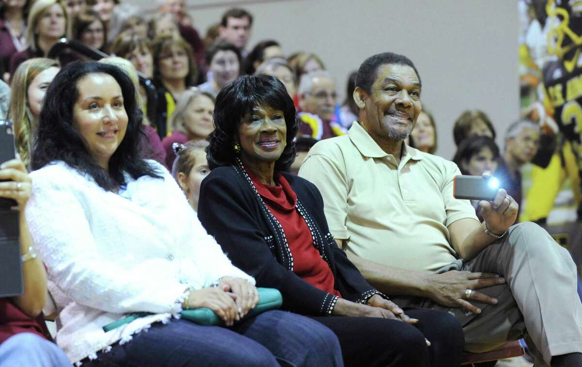 Valerie Robinson, left, mother of Corey Robinson, and Corey's grandparents, Freda and Ambrose Robinson, watch him speak during a ceremony to announce his selection to the U.S. Army All-American Bowl at San Antonio Christian High School on Friday, Nov. 30, 2012. Corey is the son of NBA legend David Robinson.