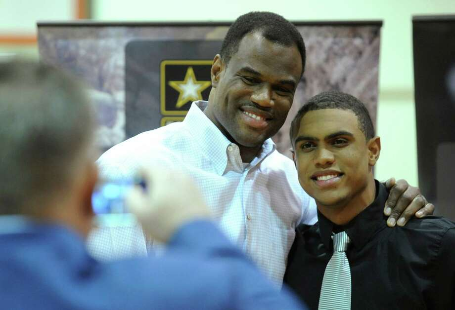 Former San Antonio Spurs center David Robinson poses for a picture with his son, Corey, after Corey's selection to the U.S. Army All-American Bowl at San Antonio Christian High School on Friday, Nov. 30, 2012. Photo: Billy Calzada, Express-News / SAN ANTONIO EXPRESS-NEWS