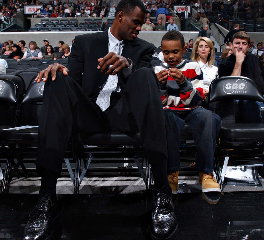 David Robinson lets his son Corey, 8, wear his championship ring before the Spurs vs. Jazz game Monday, November 10, 2003. Robinson's jersey was retired in a ceremony after the game. NICOLE FRUGE/SAN ANTONIO EXPRESS-NEWS Photo: Nicole Fruge, Express-News / San Antonio Express-News