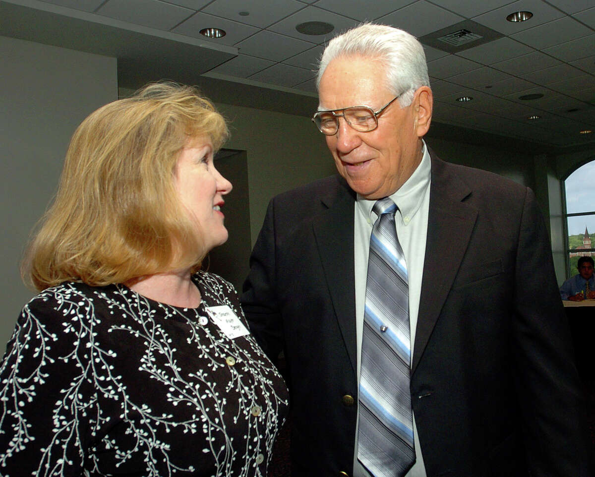 Sharon Mayer chats with former St. Gerard High School football coach and athletic director George Pasterchick at the Sky Room at the University of the Incarnate Word on June 17, 2006. Pasterchick, who retired June 2 after 34 years at St.Gerard, was honored with a banquet at UIW. He served as AD and coach of the Royals for 32 of those years and had a 152-185-2 record.