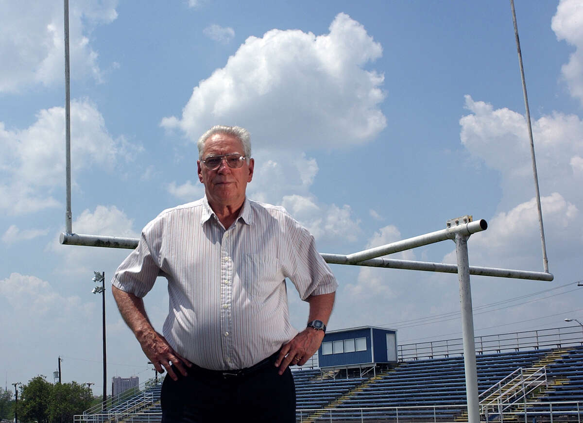 George Pasterchick was best known for his 34 years at St. Gerard, including 32 as football coach and athletic director. His Royals won eight district titles and the 1985 TCIL state title. Pasterchick is seen here posing for a photo May 2, 2006, before retiring as football coach at St. Gerard.