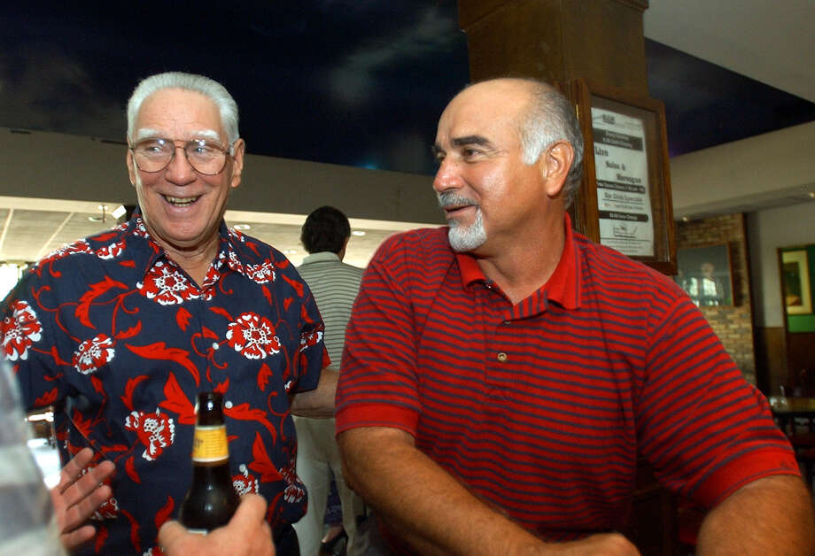 George Pasterchick, former coach of the the San Antonio Toros, enjoys a moment with Sal Olivas, a quarterback on the team, during a reunion at Arjon's on Aug. 16, 2003. The Toros semi-professional football team played in San Antonio from 1967-74 and drew big crowds to their games at Alamo Stadium. Photo: Billy Calzada, San Antonio Express-News