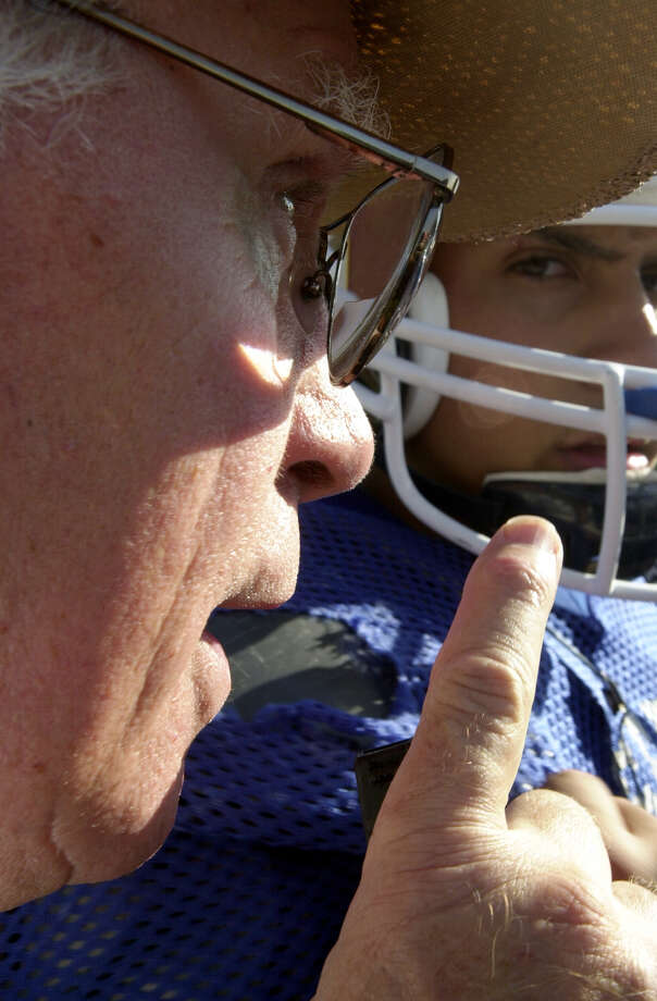A St. Gerard player focuses on coach George Pasterchick during a practice huddle at the high school on Oct. 15, 2001. Pasterchick, 71, is in his 31st season with the Royals. Photo: Express-News File Photo / SAN ANTONIO EXPRESS-NEWS