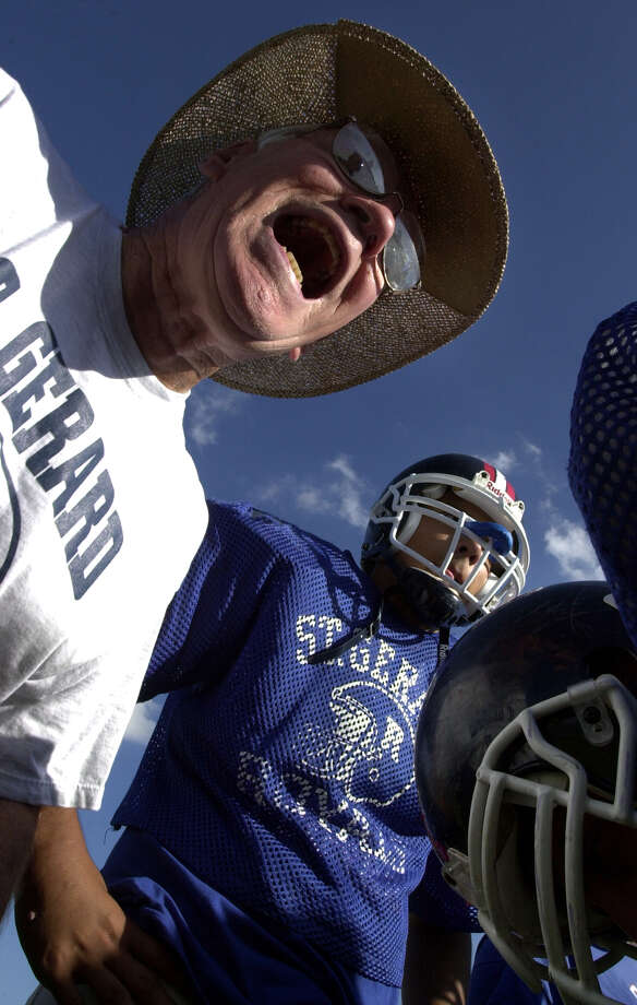 St. Gerard coach George Pasterchick provides a play during a practice huddle at the high school on Oct. 15, 2001. Pasterchick, 71, is in his 31st season with the Royals. Photo: Express-News File Photo