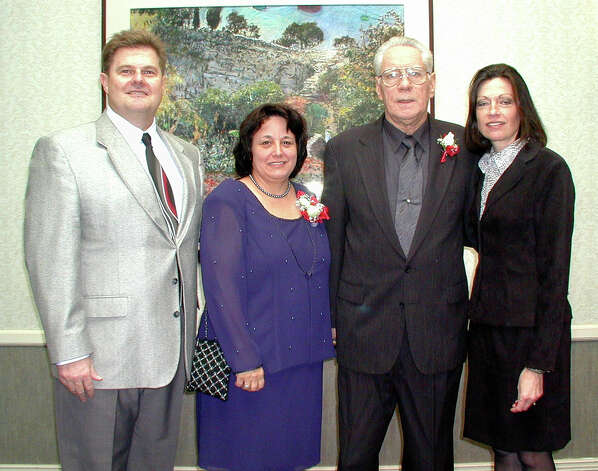 Superintendent of Catholic schools Dale Hoyt, honorees Elisa Galloway and George Pasterchick, and event chair Mary Anne Oehler attend the Catholic Education Awards Dinner at the Omni Hotel on Feb. 3, 2001. Photo: Leland A. Outz, For The Express-News