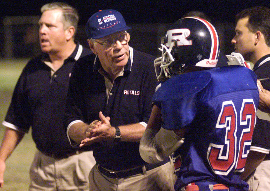 St. Gerard head coach George Pasterchick encourages running back Ty Hardin during their game against San Marcos Baptist Academy on Oct. 13, 2000. Photo: Tom Reel, San Antonio Express-News