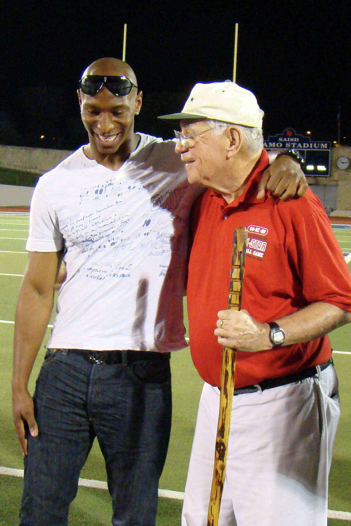 Dallas Cowboys wide receiver Sam Hurd embraces coach George Pasterchick at 2010 H-E-B San Antonio High School All-Star Football Game on May 17, 2010. Hurd played for Pasterchick in this game in 2002.