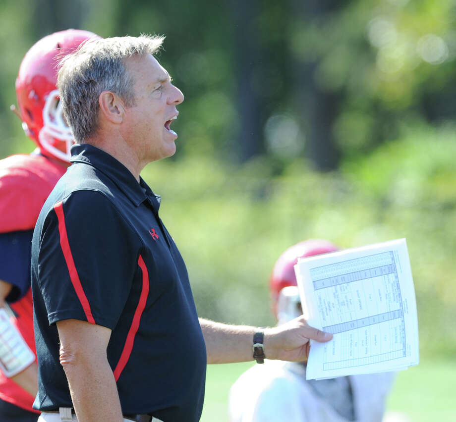 New Canaan High School Head Football Coach Lou Marinelli, right, during football practice at the school, Wednesday, Sept. 12, 2012. Photo: Bob Luckey / Greenwich Time