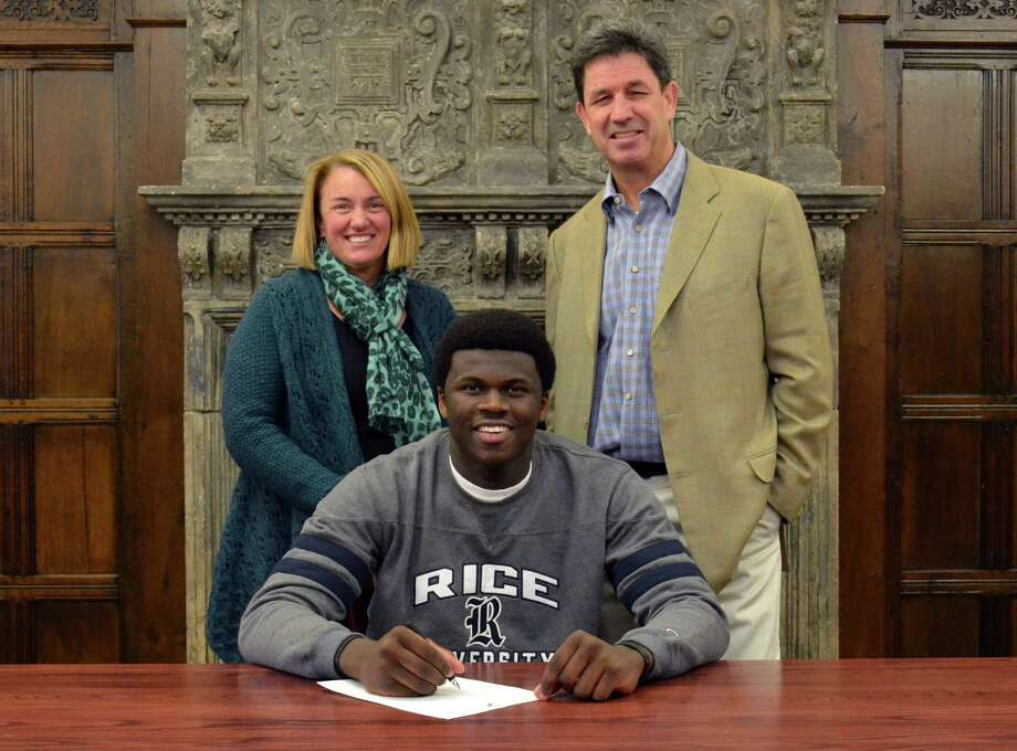 Greens Farms Academy's Sean Obi signs his National Letter of Intent to play basketball at Rice University. Standing with him is Athletic Director Tauni Butterfield and basketball coach Doug Scott. Photo: Contributed Photo / Stamford Advocate Contributed