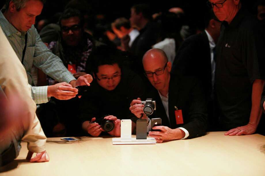 Members of the media get a hands-on look at the iPhone 5 after Apple introduced an improved line of products at the Yerba Buena Center for the Arts on Wednesday Sep. 12, 2012 in San Francisco, Calif. Photo: Mike Kepka, The Chronicle / ONLINE_YES