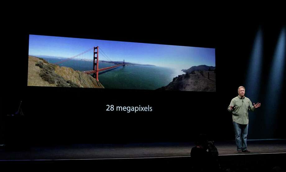 Phil Schiller, Apple's senior vice president of worldwide marketing, speaks about camera quality of the iPhone 5 during an Apple event in San Francisco, Wednesday, Sept. 12, 2012. Photo: Jeff Chiu, Associated Press / AP