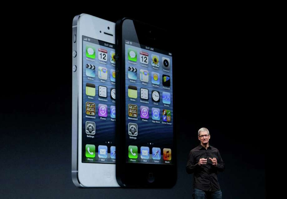 Apple CEO Tim Cook speaks in front of an image of the iPhone 5 during an Apple event in San Francisco, Wednesday, Sept. 12, 2012. Photo: Jeff Chiu, Associated Press / AP