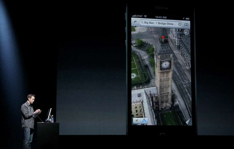 Scott Forstall, Apple's senior vice president of iOS Software, shows features on the iPhone 5 during an Apple event in San Francisco, Wednesday, Sept. 12, 2012. Photo: Jeff Chiu, Associated Press / AP