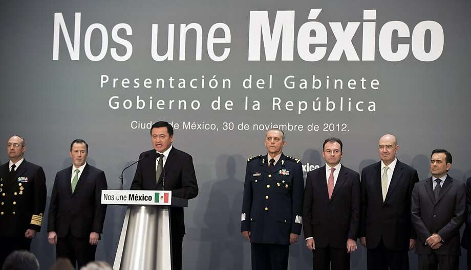 (L-R) Mexican New Navy Secretary, Admiral Vidal Francisco Soberon, New Secretary of Foreign Affairs, Jose Antonio Meade, new Interior Secretary, Miguel Angel Osorio Chong, new Defense Secretary, Salvador Cienfuegos Zepeda, new Finance Secretary, Luis Videgaray, new Secretary of Environment and Natural Resources, Juan Jose Guerra, and new Mexican Economy Secretary, Ildefonso Guajardo Villarreal, attend a ceremony in which incoming Mexican president Enrique Pena Nieto's cabinet was presented to the press on November 30, 2012. AFP PHOTO/ Yuri CortezYURI CORTEZ/AFP/Getty Images Photo: Yuri Cortez, AFP/Getty Images