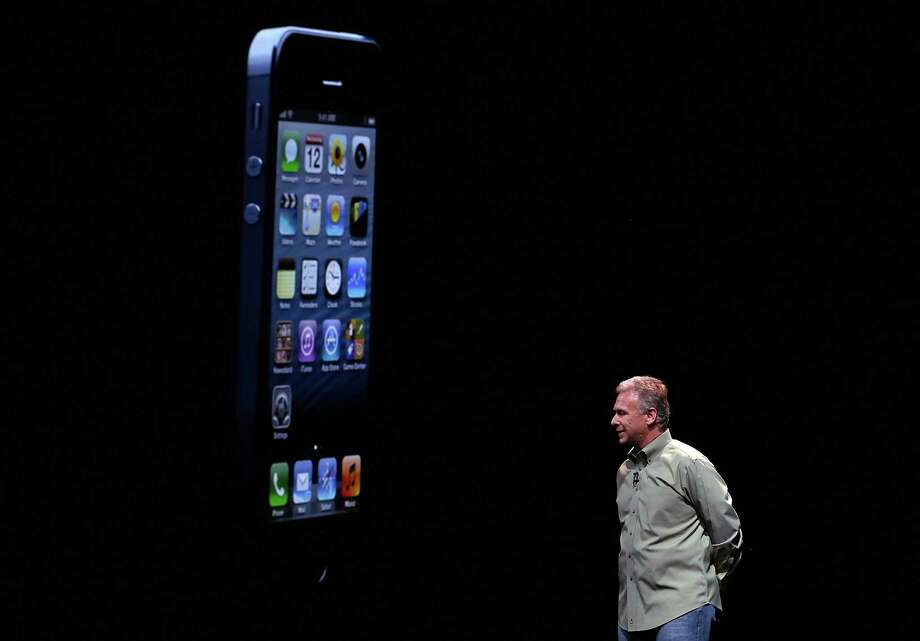 Apple Senior Vice President of Worldwide product marketing Phil Schiller announces the new iPhone 5 during an Apple special event at the Yerba Buena Center for the Arts on September 12, 2012 in San Francisco, California. Apple announced the iPhone 5, the latest version of the popular smart phone. Photo: Justin Sullivan, Getty Images / 2012 Getty Images