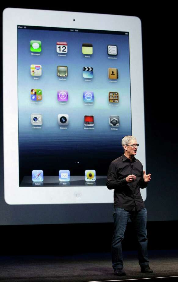 Apple CEO Tim Cook speaks in front of an image of an iPad during an Apple event in San Francisco, Wednesday, Sept. 12, 2012. Photo: Jeff Chiu, Associated Press / AP