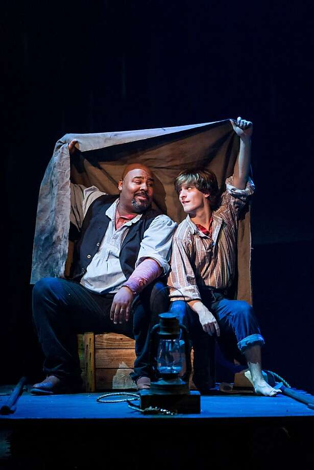 "James Monroe Iglehart (left) carries the show as the slave Jim with Alex Goley as Huck as they seek shelter from the rain in the musical ""Big River"" at TheatreWorks. Photo: Mark Kitaoka"