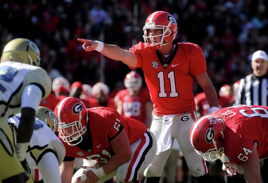 FILE - In this Nov. 24, 2012, file photo, Georgia quarterback Aaron Murray (11) directs this team against Georgia Tech during the second half of an NCAA college football game in Athens, Ga. Alabama's AJ McCarron and Murray have piloted their teams into the SEC championship game as the nation's two most efficient passers.(AP Photo/John Amis, File) Photo: John Amis, Associated Press / FR69715 AP