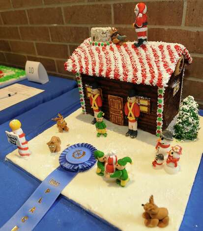 "Entry #20 is ""Santa's Workshop,"" and is the first place winner in the professional division. The Golden Triangle Chapter of the Texas Chefs Association and the Lamar University Hospitality Program are hosting the 7th Annual Gingerbread Competition Thursday November 29, 2012 with proceeds benefiting Buckner Children and Family Services. Entries were judged Thursday afternoon starting at 2 p.m. and all entries will remain on display through Sunday, Dec. 2 at the Beaumont Civic Center, located at 701 Main St. where the community is invited to view the houses and bid on them through silent auction. They were held for the first time in conjunction with the Main Street Market which opens at 5p.m. Thursday. Dave Ryan/The Enterprise Photo: Dave Ryan"