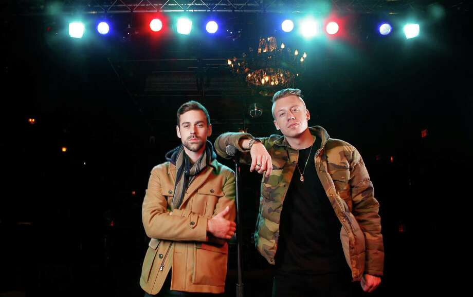Ben Haggerty, better known by his stage name Macklemore (right), and his producer Ryan Lewis make left-leaning, socially conscious music. Photo: File Photo, Associated Press / Invision