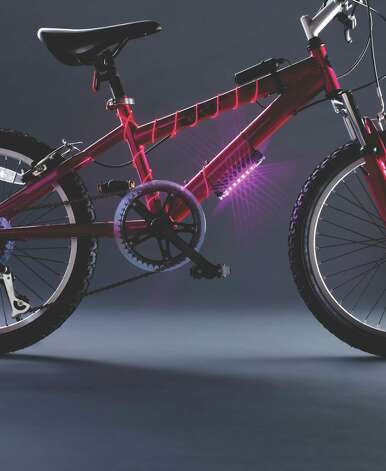 The Bike Brightz light stick can be set to a constant beam or three flashing patterns, while the Glow Brightz tubing (in constant or flashing settings) wraps around the bike.  Photo: Container Store