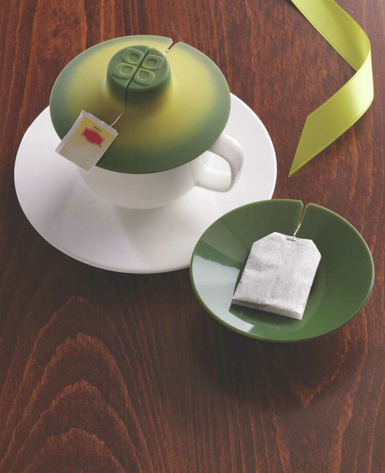 The Tea Bag Buddy keeps your tea bag in place while it steeps, traps the heat in the cup   and can be used to lift and squeeze excess tea from the bag.  Photo: Container Store