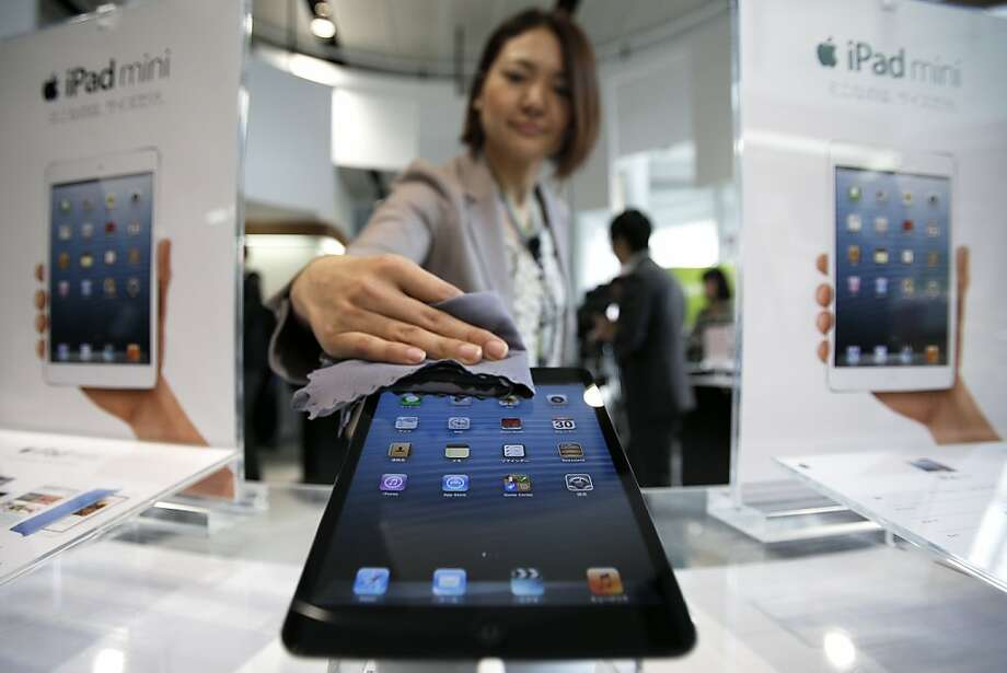 Sales of tablets like Apple's new iPad Mini are expected to outpace those of PCs by 2015. Photo: Kiyoshi Ota, Bloomberg