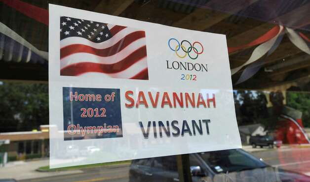 Savannah Vinsant, the 19-year-old who will compete in women's trampoline at the 2012 Olympics in London on Aug. 4, lived in Newton Texas for six years. Before Savannah qualified for the 2012 Olympics, her parents, Neil and Ramonda Vinsant, opened the Twist & Shout Gymnastics and Cheer Studios to give her a place to train and her mother was one of her trainers.   Signs around the town of Newton, like this one at the high school, show the support for Vinsant.  Dave Ryan/The Enterprise Photo: Dave Ryan