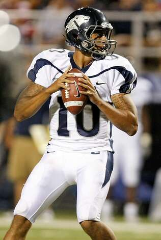 LAS VEGAS - OCTOBER 02:  Quarterback Colin Kaepernick #10 of the Nevada Reno Wolf Pack looks to pass against the  UNLV Rebels in the third quarter of their game at Sam Boyd Stadium October 2, 2010 in Las Vegas, Nevada. Nevada Reno won 44-26.  (Photo by Ethan Miller/Getty Images) Photo: Ethan Miller, Getty Images