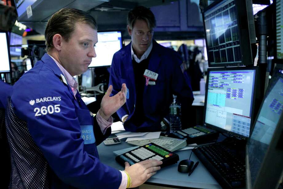 FILE - In this Nov. 15, 2012 file photo, traders work on the floor of the New York Stock Exchange. Uncertainty over whether U.S. leaders can resolve a critical budget deadlock and figures showing the eurozone's unemployment rate at a record high capped any gains to be made in the markets Friday, Nov. 30, 2012. (AP Photo/Seth Wenig, File) Photo: Seth Wenig