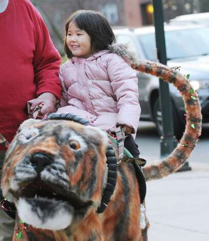 Mari Tsubota, 4, of Greenwich, smiles while riding a mechanical snowcat during the Department of Parks and Recreation annual tree-lighting ceremony at Greenwich Town Hall, Friday afternoon, Nov. 30, 2012. Photo: Bob Luckey / Greenwich Time