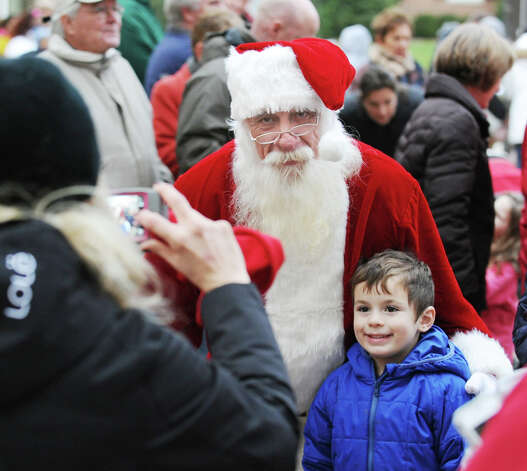 Benjamin Lombardi, 4, of Cos Cob, gets his photo taken with Santa Claus during the Department of Parks and Recreation annual tree-lighting ceremony at Greenwich Town Hall, Friday afternoon, Nov. 30, 2012. Photo: Bob Luckey / Greenwich Time