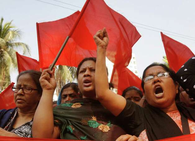 Bangladeshi garment workers shout slogans as they participate in a protest to mourn the death of the victims of a fire in a garment factory in Dhaka, Bangladesh, Friday, Nov. 30, 2012. Hundreds of garment workers protested Friday outside the Bangladeshi factory where 112 people were killed by the fire, demanding compensation for their lost salaries. (AP Photo/Pavel Rahman) Photo: Pavel Rahman