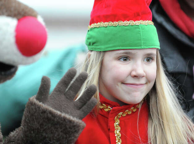 Erika Bloes, 13, of Greenwich, was dressed as an elf during the Department of Parks and Recreation annual tree-lighting ceremony at Greenwich Town Hall, Friday afternoon, Nov. 30, 2012. Photo: Bob Luckey / Greenwich Time