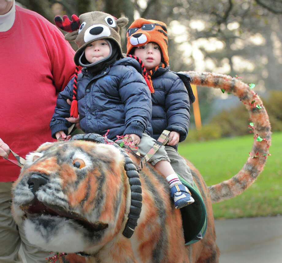 Twins Oscar (left) and Dylan Gross, 2, of Greenwich, ride a snowcat during the Department of Parks and Recreation annual tree-lighting ceremony at Greenwich Town Hall, Friday afternoon, Nov. 30, 2012. Photo: Bob Luckey / Greenwich Time