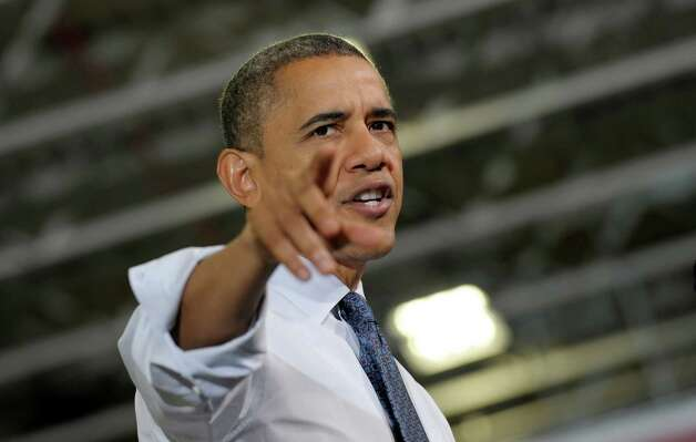 President Barack Obama gestures as he speaks at the Rodon Group, which manufactures over 95% of the parts for K'NEX Brands toys, Friday, Nov. 30, 2012, in Hatfield, Pa. The visit comes as the White House continues a week of public outreach efforts, while also attempting to negotiate a deal with congressional leaders.  (AP Photo/Susan Walsh) Photo: Susan Walsh
