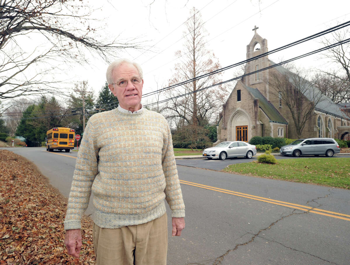 Bill Howland, president of the Riverside Association, stands on Riverside Avenue across from St. Paul's Episcopal Church, Friday afternoon, Nov. 30, 2012. Howland, who lives in the neighborhood and attends the church, sees it as an anchor for the community.