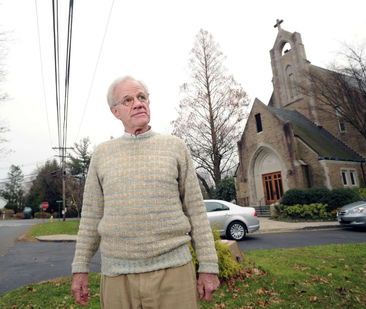 Bill Howland, president of the Riverside Association, in front of St. Paul's Episcopal Church in Riverside, Friday afternoon, Nov. 30, 2012. Howland, who lives in the neighborhood and attends the church, sees it as an anchor for the community.