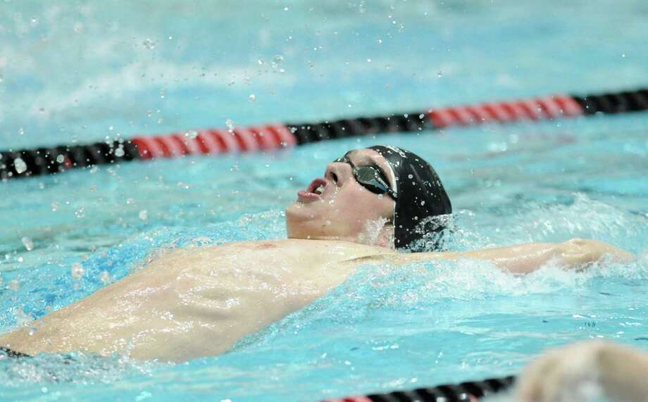 Nathaniel Boley of Staples swims the 100 yard backstroke during the CIAC Boys Class LL Swimming championships at Wesleyan University in Middletown, Conn., Wednesday, March 14, 2012. Photo: Bob Luckey / Greenwich Time