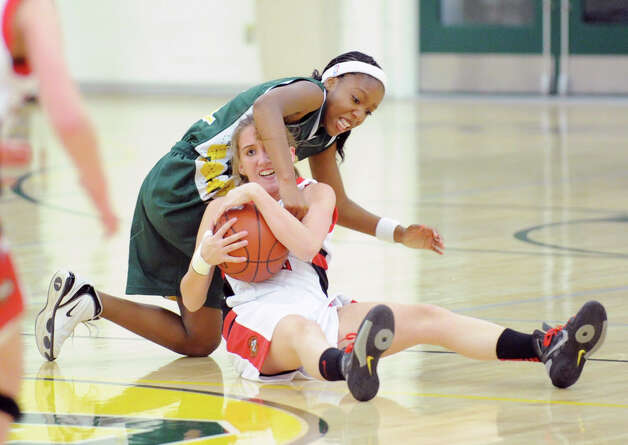 At top, Kennedy Woods of Greenwich Academy goes for a loose ball as does Kingswood-Oxford School's Brittany Vose, bottom, during the O'Neil S. Medley Memorial Basketball Tournament at Greenwich Academy, Friday night, Nov. 30, 2012. Kingswood-Oxford defeated Greenwich Academy, 47-33. Photo: Bob Luckey / Greenwich Time