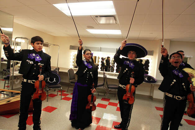 From left, Oscar Montes, Elizabeth Guzman, Nicholas Hernandez, and Israel Salgado rehearse as Mariachi Pantera from Jefferson Davis High School in Houston prepares for the Group Competition during the 18th annual Mariachi Vargas Extravaganza at  Lila Cockrell Theatre, Friday, November 30, 2012. Photo: JENNIFER WHITNEY / © Jennifer Whitney