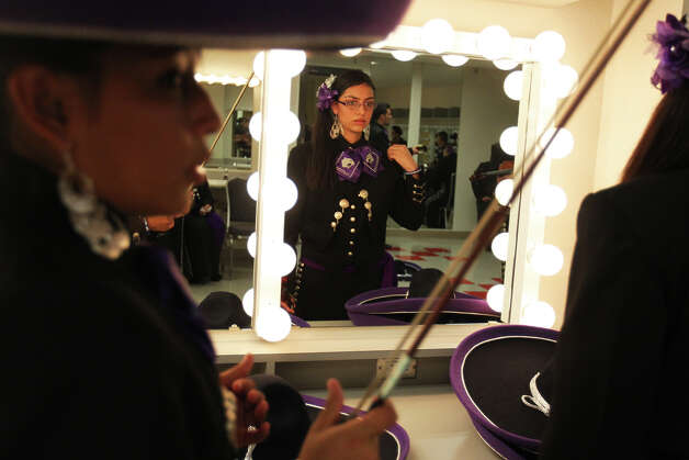 Justine Williams, left, and Elizabeth Guzman get rear in the dressing room as Mariachi Pantera from Jefferson Davis High School in Houston prepares for the Group Competition during the 18th annual Mariachi Vargas Extravaganza at  Lila Cockrell Theatre, Friday, November 30, 2012. Photo: JENNIFER WHITNEY / © Jennifer Whitney