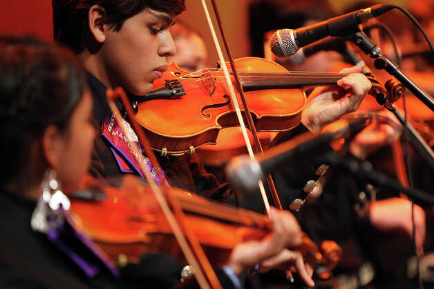 Violinist Oscar Montes, 15, performs with Mariachi Pantera from Jefferson Davis High School in Houston as they compete in the Group Competition during the 18th annual Mariachi Vargas Extravaganza at  Lila Cockrell Theatre, Friday, November 30, 2012. (JENNIFER WHITNEY) Photo: JENNIFER WHITNEY, For The Express-News / © Jennifer Whitney